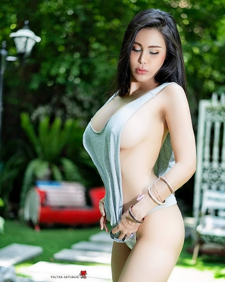 Ning Patinya with an open and transparent white top