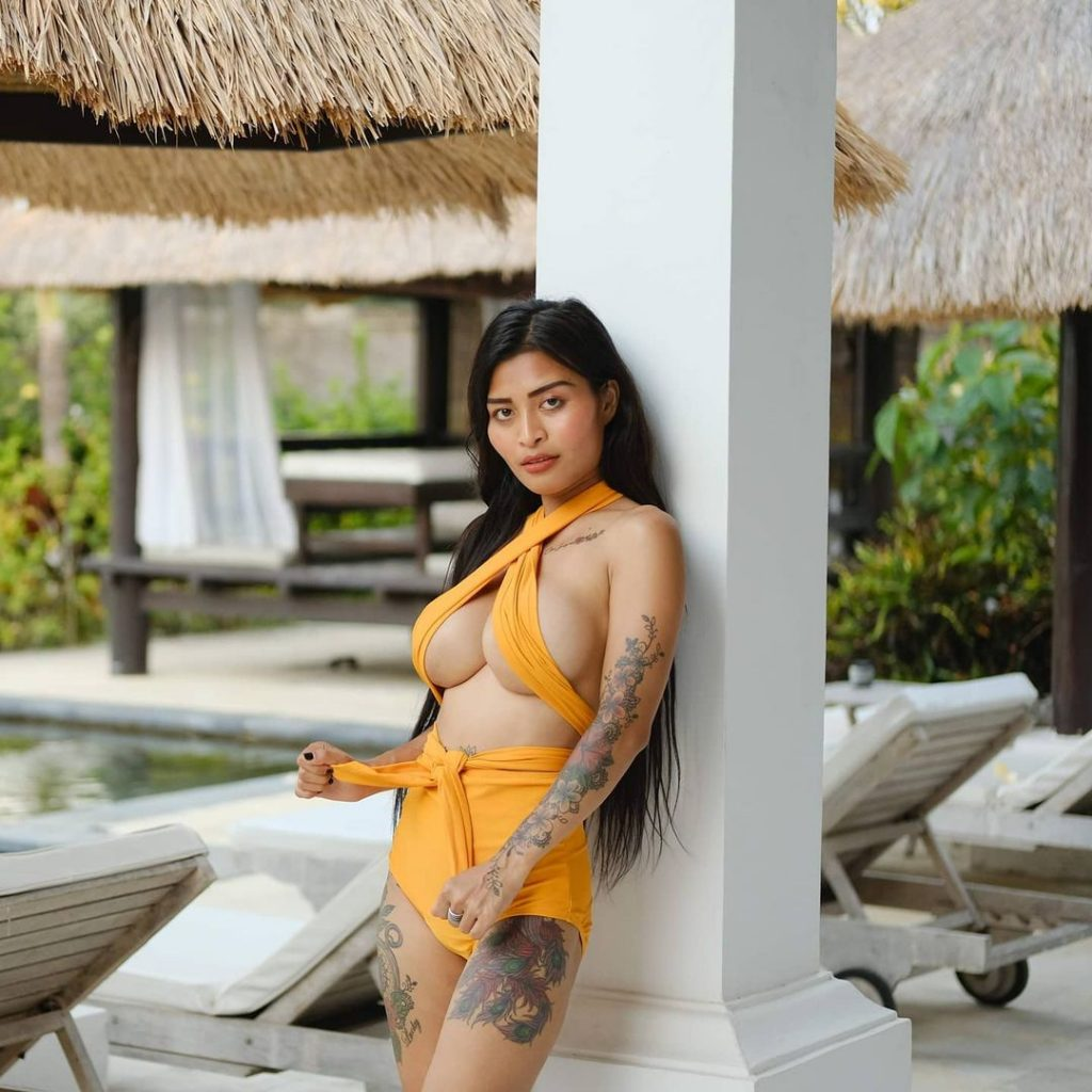 Inked Thai girl yellow bikini sexy Coco Suay