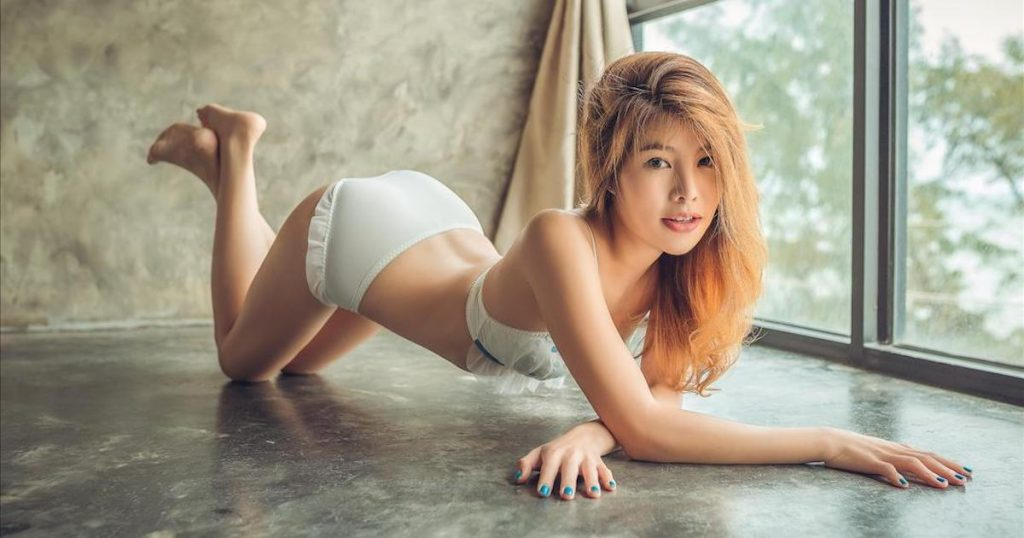 sexy Thai girl Vong Thammavong in white lingerie crawling on the floor