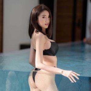 Minggomut Maming Kongsawas wearing a black bikini in a pool