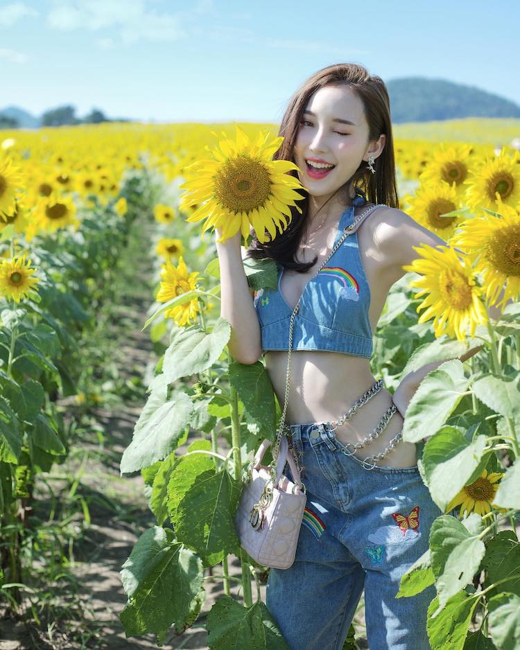 Thai model May Sitapha photoshoot in a sunflower field